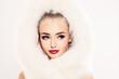 Beautiful Winter Woman Fashion Model in White Fur