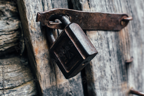 Poster padlock on the old wooden door