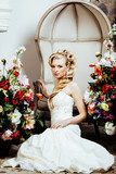 beauty young bride alone in luxury vintage interior with a lot of flowers close up
