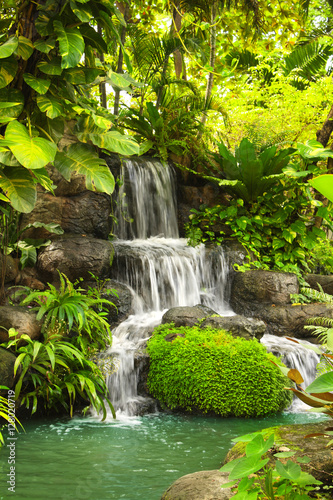 Waterfall in tropical garden - 128020719