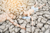 Double exposure of  a boy faint on dry ground .concept drought