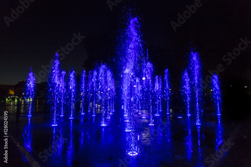 Poster Colorfully lit fountain