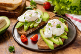 Healthy sandwiches with poached egg and avocado - 128039519