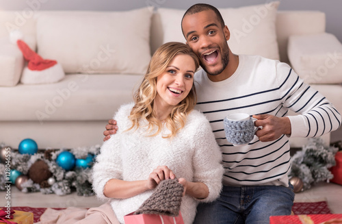 Poster Cheerful happy couple having great time together