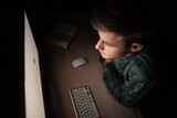 Man sitting and working with computer in the dark room