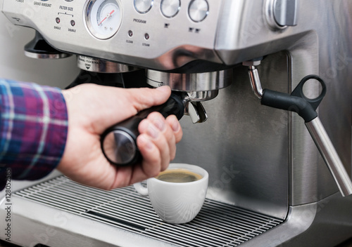 Poster Professional espresso machine pouring strong looking fresh coffee