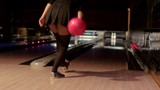 sexy blonde in short black dress playing bowling