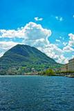 Swiss houses at Lake Lugano and Alps mountains Ticino
