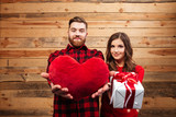 Couple with gift and heart