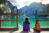 Fototapety girl backpacker looking at Braies lake