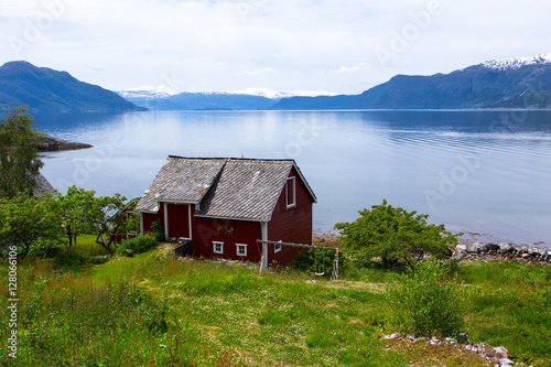 Poster rural house on a fjord coast