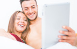 Young couple watching something on the digital tablet