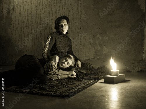 Poster Toned image adult woman sitting on the floor and sadly looks and the young boy s