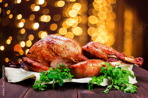 Fotobehang Restaurant Roasted Turkey. Thanksgiving table served with turkey, decorated with greens and basil on dark wooden background. Homemade roasted chicken. Christmas holiday dinner. Top view