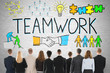 Businesspeople Looking At Teamwork Concept On Wall