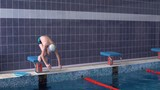Man dives into the pool