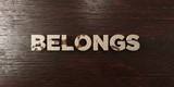 Belongs - grungy wooden headline on Maple  - 3D rendered royalty free stock image. This image can be used for an online website banner ad or a print postcard.