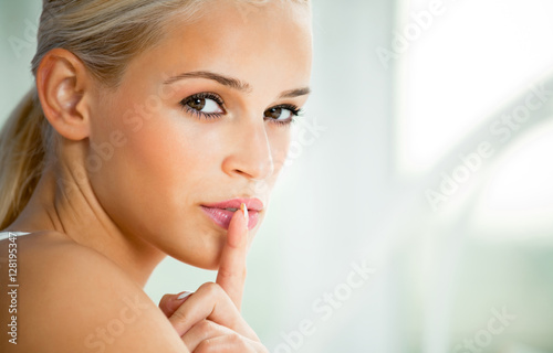 young woman with finger on lips Poster