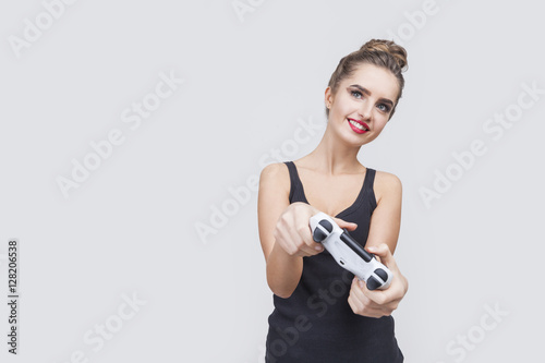 Poster Gamer girl with a bun and controller