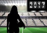 Composite image of 2017 with silhouette of woman holding ball