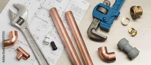 Plumbers Tools and Plumbing Materials Banner on House Plans - 128247930