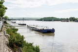 Metallic mooring for boats and bridge over the Danube River