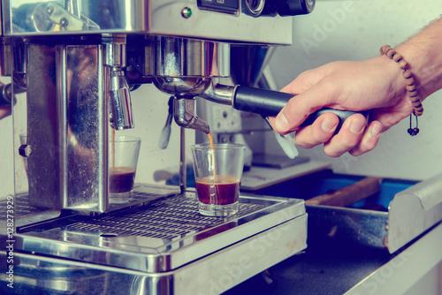 Poster man using espresso machine with portafilter
