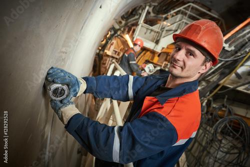 underground metro railway builder at tunnel construction work Plakát