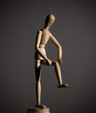 The wooden figure of a man