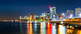 Jersey City skyline panorama by night, reflected in Hudson River, with Verrazano–Narrows Bridge in the background - 128294515