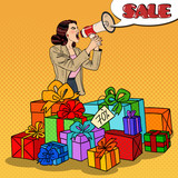 Pop Art Woman with Megaphone Promoting Big Sale Standing in Gift Boxes. Vector illustration