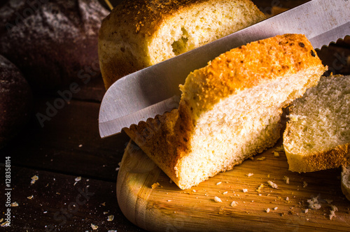 Poster bakery products. Meat loaf sliced on a wooden background