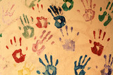 Hand prints painted on a wall.