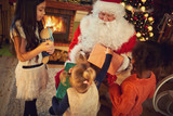 Group of multiethnic girls with Santa Claus