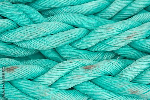 Fotobehang Schip Nautical background. Old blue frayed ship rope closeup.