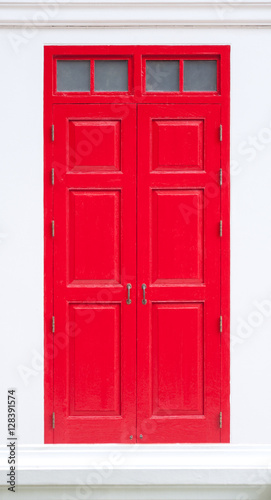 traditional red door wooden of an old on white wall,in Thailand © rawintanpin