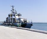 Naval ship near pier