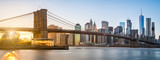 The panorama view of Brooklyn Bridge with Lower Manhattan in the background, lit by sunset - 128405539