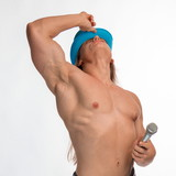 singer bodybuilder shirtless with long hair in a blue hat with a microphone on a white background