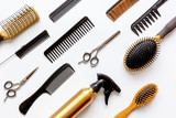 Fototapety combs and hairdresser tools on white background top view