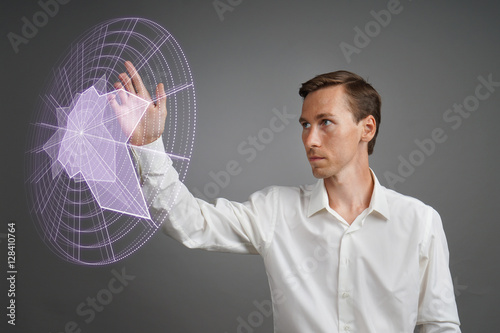 Man working with interactive Sci-Fi HUD interface. Poster