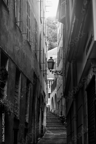 Beautiful view of scenic narrow alley street with historic traditional houses in an old town in Europe with blue sky and clouds in summer sunny day, with retro vintage Instagram warm filter effect © morozov_photo
