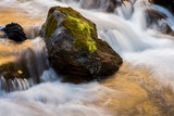 A long exposure of West Maroon Creek cascading around moss-cover