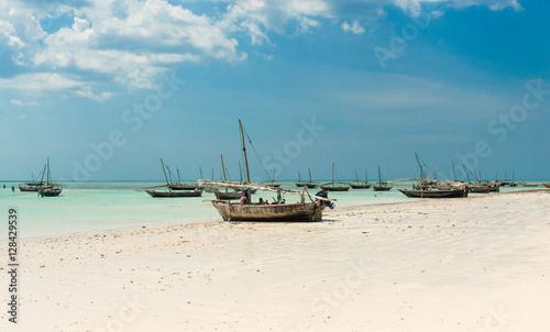 Fotobehang Overige landscape with fishing boats on the shore, Zanzibar