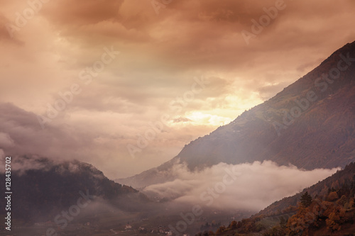 Fototapeta Beautiful pink sunset in the mountains. Italian Alps in South Ty