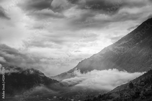 Beautiful sunset in the mountains. Black and white landscape wit - 128435709