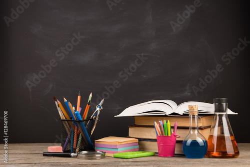Fototapeta Education concept - books on the desk in the auditorium