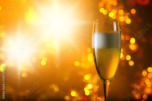 Poszter  glass of champagne on a background of Christmas  decoration