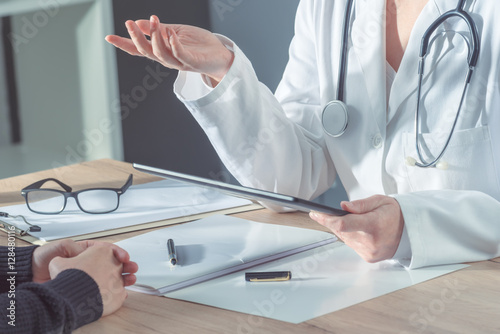 Doctor advising patient in hospital office