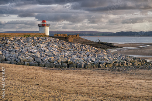 Poster The sandy beach and light house at Burry Port, Llanelli, Carmarthenshire